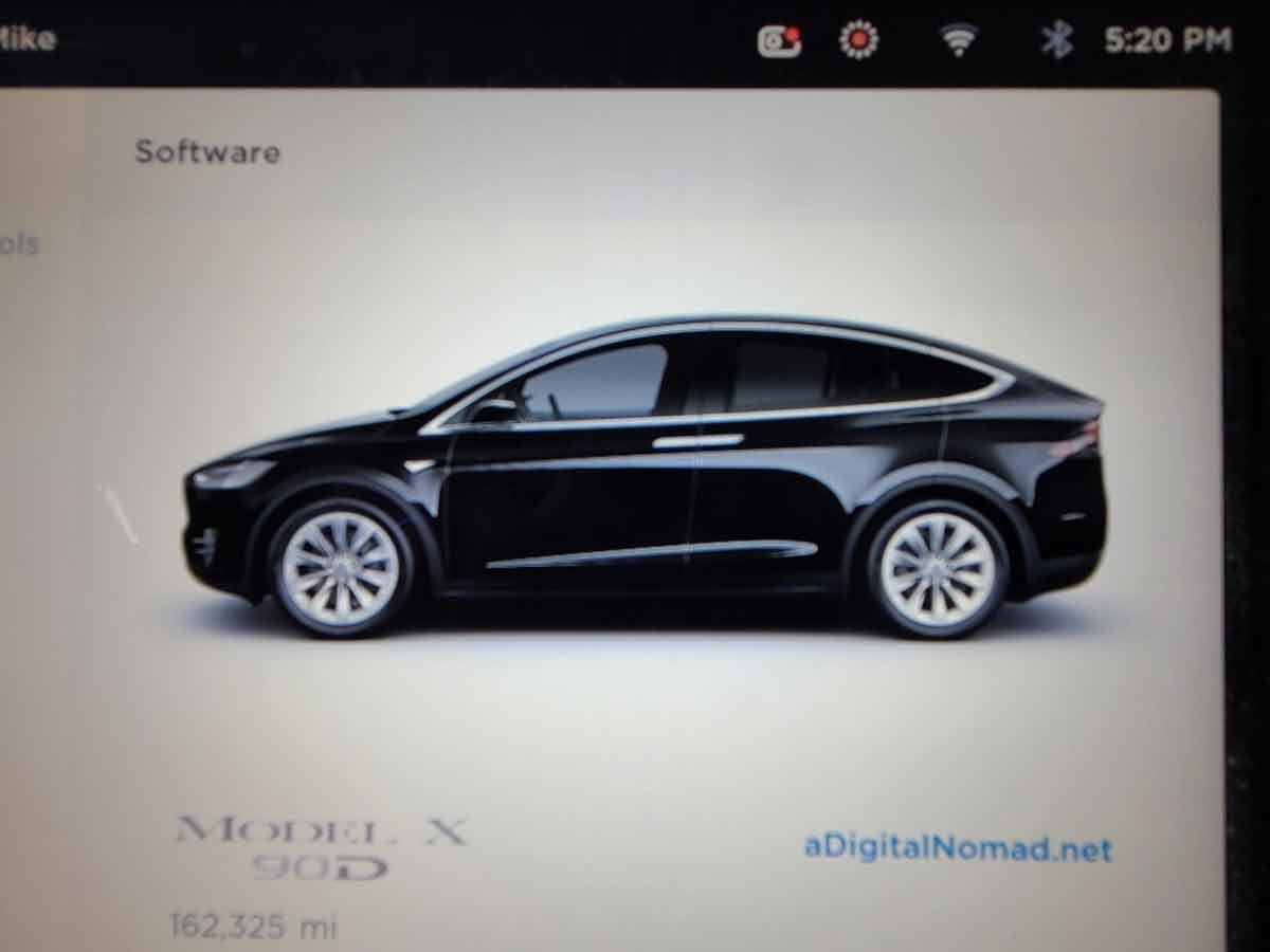 Tesla Model X monitor screenshot showing very high mileage